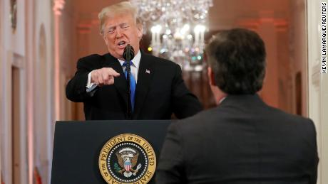 President Donald Trump points at CNN's Jim Acosta and accuses him of