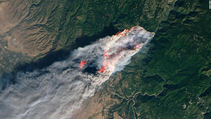 A satellite image taken by NASA's Operational Land Imager shows the Camp Fire in Northern California.