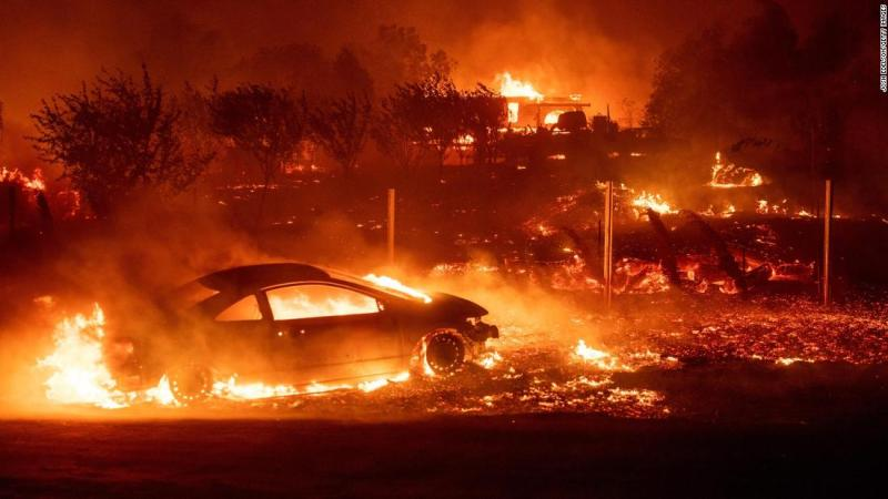 Vehicles and homes burn as the Camp Fire rips through Paradise on November 8.