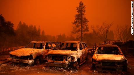 Scorched cars sit on a used car lot during the Camp Fire in 2018.