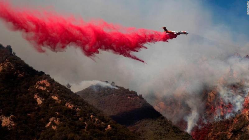 A plane drops fire retardant on a burning hillside on November 11 in Malibu.