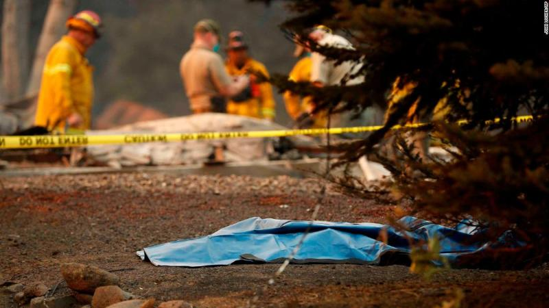 A bag containing human remains lies on the ground on November 11 as officials continue to search for victims at a burned-out home in Paradise.