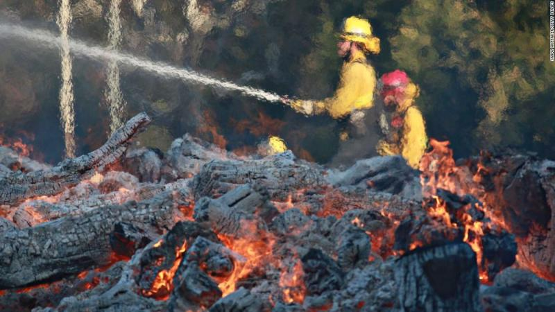 Firefighters battle a blaze at the Salvation Army Camp in Malibu, California, on Saturday, November 10.