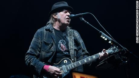 Neil Young says that his application for American citizenship has been suspended because he uses marijuana