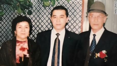 Uyghur journalist Gulchehra Hoja's brother and parents in an undated family photo