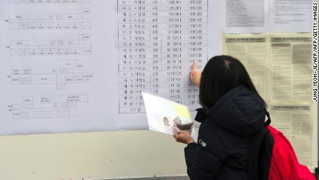 A student checks her exam room number before the annual College Scholastic Ability Test, a standardised exam for college entrance, at a high school in Seoul on November 23, 2017.