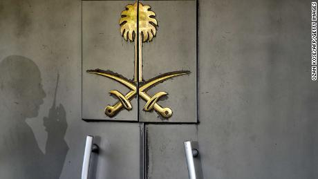 A shadow of a security member of the consulate is seen on the door of the Saudi Arabian consulate on November 1, 2018 in Istanbul. - Journalist Jamal Khashoggi was strangled as soon as he entered the Saudi consulate in Istanbul and his body was dismembered and destroyed as part of a premeditated plan, Turkey's chief prosecutor said on October 31, making details of the murder public for the first time. (Photo by OZAN KOSE / AFP)        (Photo credit should read OZAN KOSE/AFP/Getty Images)