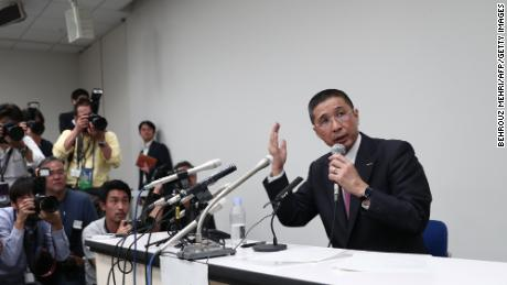 Nissan Motors CEO Hiroto Saikawa speaks during a press conference, detailing the allegations against Ghosn.