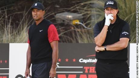 Woods and Mickelson look on from the seventh tee.