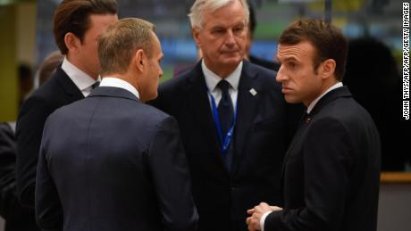 France's President Emmanuel Macron talks with EU chief Brexit negotiator Michel Barnier, Austria's Chancellor Sebastian Kurtz and European Council President Donald Tusk before the summit.