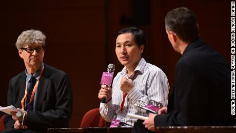 Chinese scientist He Jiankui in a discussion with head of the Laboratory of Stem Cell Biology and Developmental Genetics at the Francis Crick Institute, Robin Lovell-Badge.