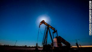 Oil fell below $50 a barrel for the first time in over a year