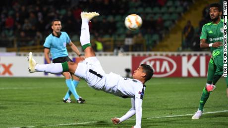 Sporting Lisbon's Colombian forward Freddy Montero acrobatically kicks the ball in the game against Vorskla.