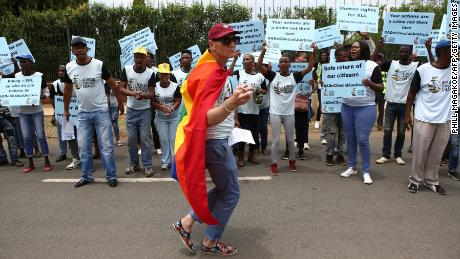 South African members of the LGBTQI community protest outside the Tanzania High Commission.