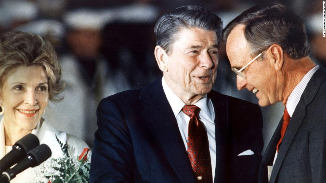 Reagan shakes hands with Bush in 1988. Bush served as Reagan's vice president from 1981 to 1989, and he would succeed him as President.