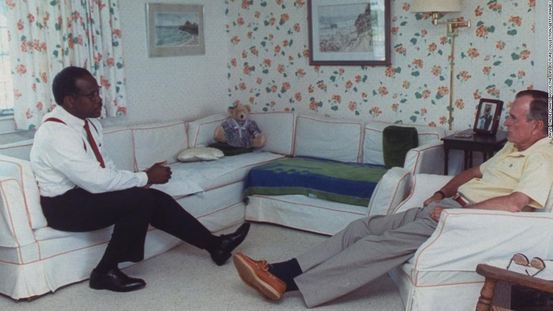 Bush, at his vacation home in Kennebunkport, meets with Supreme Court nominee Clarence Thomas in 1991. Bush also appointed Justice David Souter in 1990.
