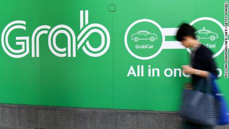 Singapore's Grab ends its game-changing year flush with cash