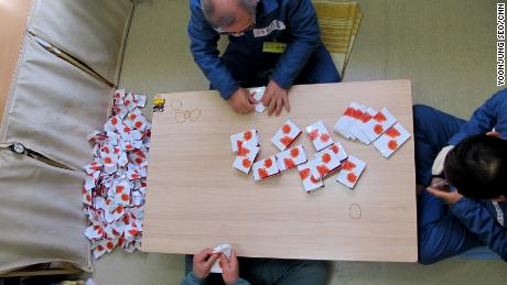 Elderly inmates make small bags in their spare time to earn a little bit of cash they can receive on their release.