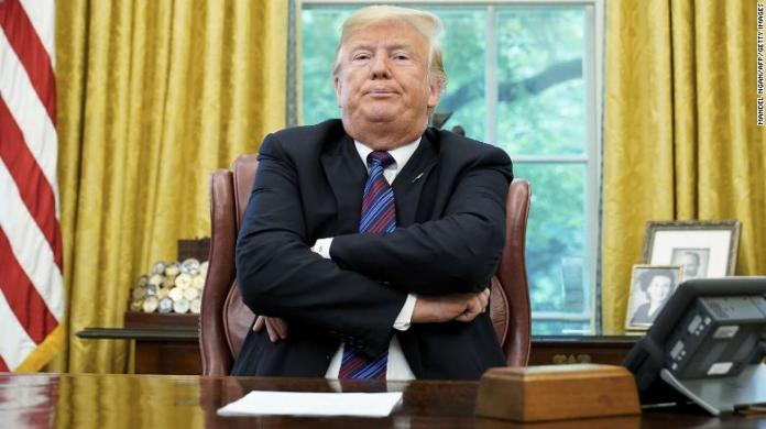 US President Donald Trump speaks to reporters after a phone conversation with Mexico's President Enrique Pena Nieto on trade in the Oval Office of the White House in Washington, DC on August 27, 2018. - President Donald Trump said Monday the US had reached a