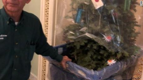 A Christmas tree in a cart is physically removed from Cornyn's office, a kind of symbol of the holidays being stolen  from the Capitol as the country faces a potential partial shutdown.