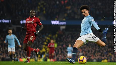 Leroy Sane scores his side's second goal in the 2-1 win over Liverpool at the Etihad.