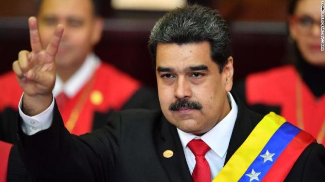 Venezuela's President Nicolas Maduro flashes a victory sign after being sworn in for his second term in Caracas on Thursday.
