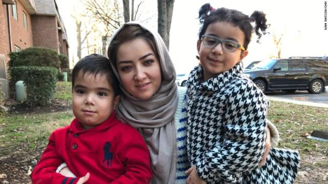 Tursun with her two surviving children, Moez (left) and Elina (right).