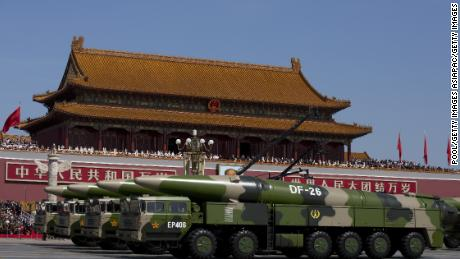 Chinese military vehicles carrying DF-26 ballistic missiles drive are seen during a 2015 military parade in Beijing.
