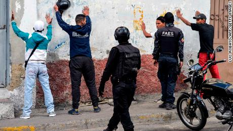 Special forces police detain a group of men during an operation in the Petare neighborhood of Caracas on Friday.