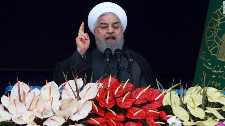 "Iranian President Hassan Rouhani speaks during a ceremony celebrating the 40th anniversary of the Islamic Revolution, at the Azadi, Freedom, Square in Tehran, Iran, Monday, Feb. 11, 2019. Speaking from a podium in central Tehran, Rouhani addressed the crowds for nearly 45 minutes, lashing out at Iran's enemies - America and Israel - and claiming that their efforts to ""bring down"" Iranians through sanctions will not succeed. (AP Photo/Vahid Salemi)"