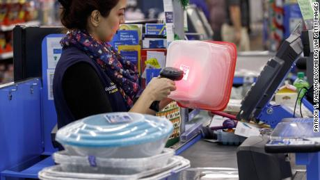 A cashier scans an item at a Walmart Inc. store in Burbank, California, U.S., on Monday, Nov. 19, 2018. To get the jump on Black Friday selling, retailers are launching Black Friday-like promotions in the weeks prior to the event since competition and price transparency are forcing retailers to grab as much share of the consumers' wallet as they can. Photographer: Patrick T. Fallon/Bloomberg via Getty Images