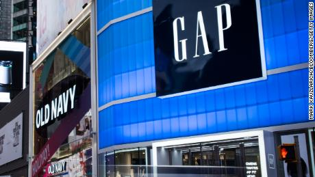 Pedestrians pass in front of Gap Inc. and Old Navy Inc. stores in the Times Square area of New York, U.S., on Wednesday, Dec. 13, 2017. Bloomberg is scheduled to release consumer comfort figures on December 21. Photographer: Mark Kauzlarich/ Bloomberg