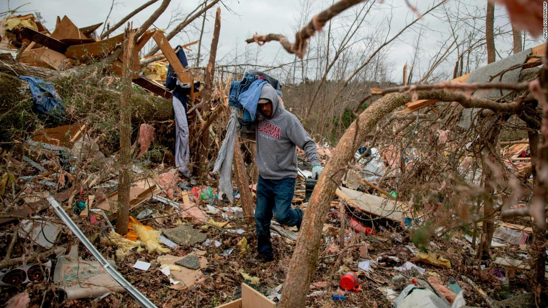 Danny Allen helps recover belongings from what's left of a friend's home in Beauregard, Alabama, on Monday, March 4.