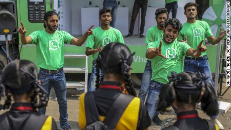 WhatsApp ambassadors perform a skit during a roadshow for the messaging service in Pune, India, in October. Cheap phones and incredible rates mean that more Indians use the app.