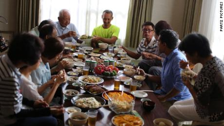 Dr. Sanjay Gupta joins a family meal in Okinawa, Japan.