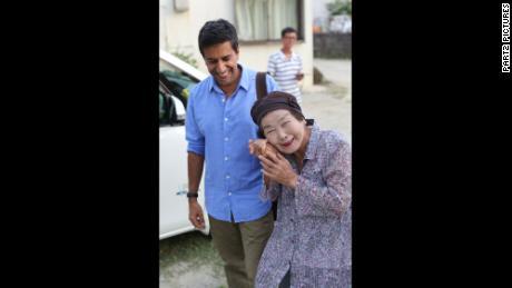 Okinawa resident Umeto Yamashiro, 97, with CNN's Dr. Sanjay Gupta.