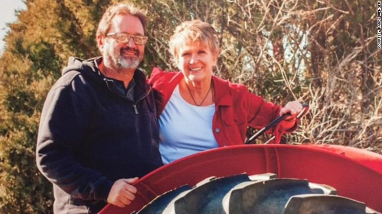 Randy Wenger with his wife on his family farm in Colorado.