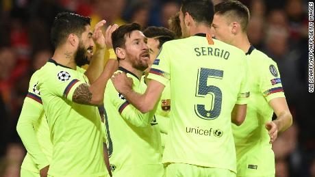 Barcelona players celebrate after scoring against Manchester United.