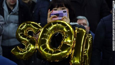 A fan of Son Heung-min of Tottenham Hotspur with a balloon honoring the South Korea star.