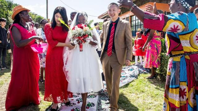 Liang Yongyu and Karen Ngunjiri were married near Mount Kenya after he converted to Christianity for her.