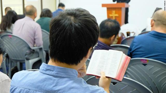 A Chinese Christian reads a Bible at a church in Nairobi.