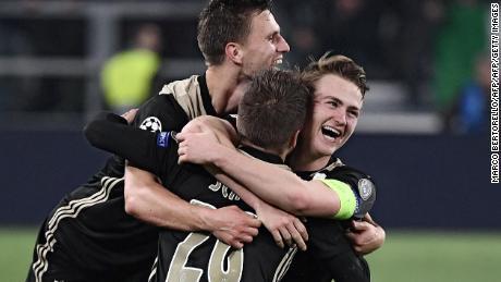 Ajax's Dutch defender Joel Veltman, Ajax's Danish midfielder Lasse Schone and Ajax's Dutch defender Matthijs de Ligt celebrate their team's win over Juventus.