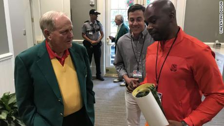 Dixon presented Jack Nicklaus with one of his drawings at the Masters. Max Adler center.