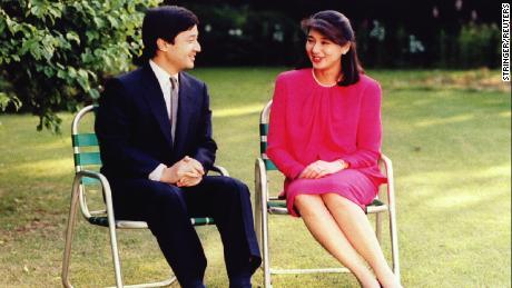 Japan's Crown Prince Naruhito chats with his then-fiancee Masako Owada, former career diplomat, in the garden of Togu Palace in Tokyo ahead of their 1993 wedding.