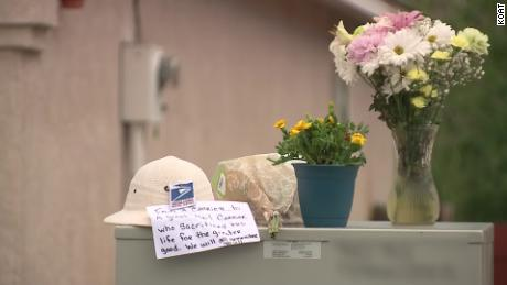 Flowers and a note were placed outside the home where the shooting happened.