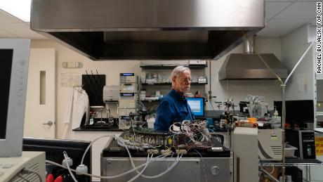 Davis in the Stanford Genome Technology Center, where his son's blood samples churn in sequencing machines.