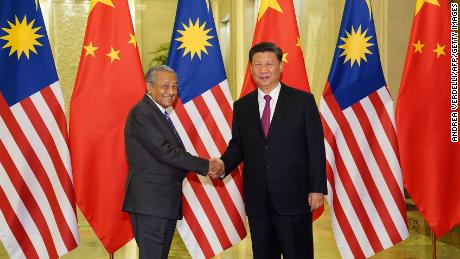 Malaysia Prime Minister Mahathir Mohamad shakes hands with President of the People's Republic of China Xi Jinping at the Diaoyutai State Guesthouse in Beijing on April 25.