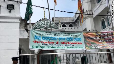Signs outside the Dewatagaha Mosque in Colombo denounce the Easter Sunday attacks.