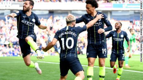 Manchester City celebrates scoring the important goal against Burnley.