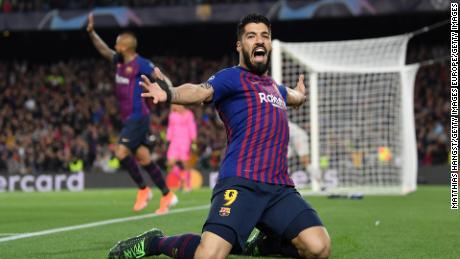 Suarez celebrates his first Champions League goal of the season.